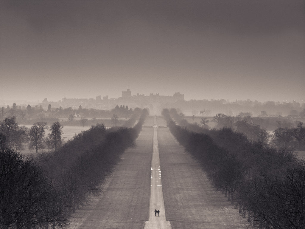 Detail of England, Berkshire, Aerial view of two people walking on long path with windsor castle in background by Assaf Frank