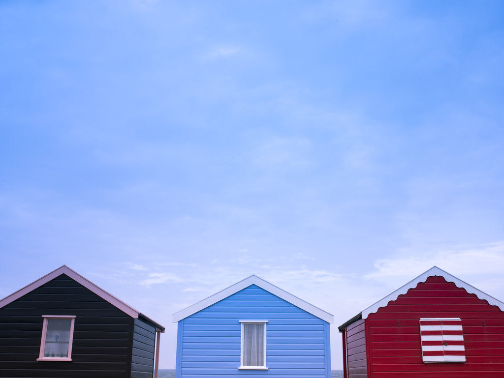 Detail of Beach huts in a row against sky by Assaf Frank