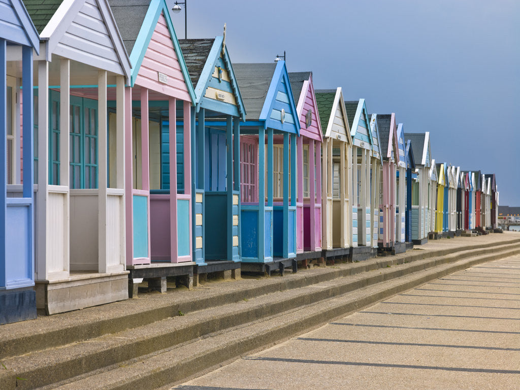 Detail of Multi coloured beach huts in a row by Assaf Frank
