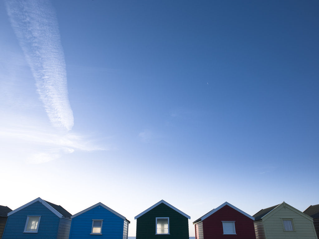 Detail of Beach huts in a row against blue skies by Assaf Frank