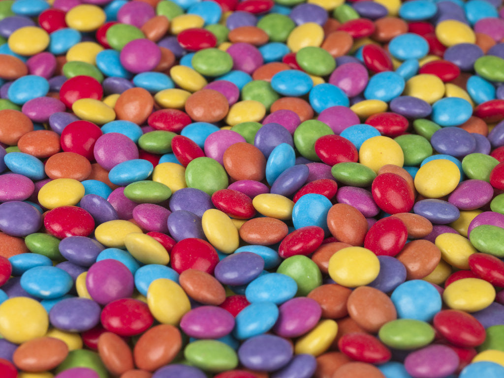 Multi colored smarties sweets by Assaf Frank