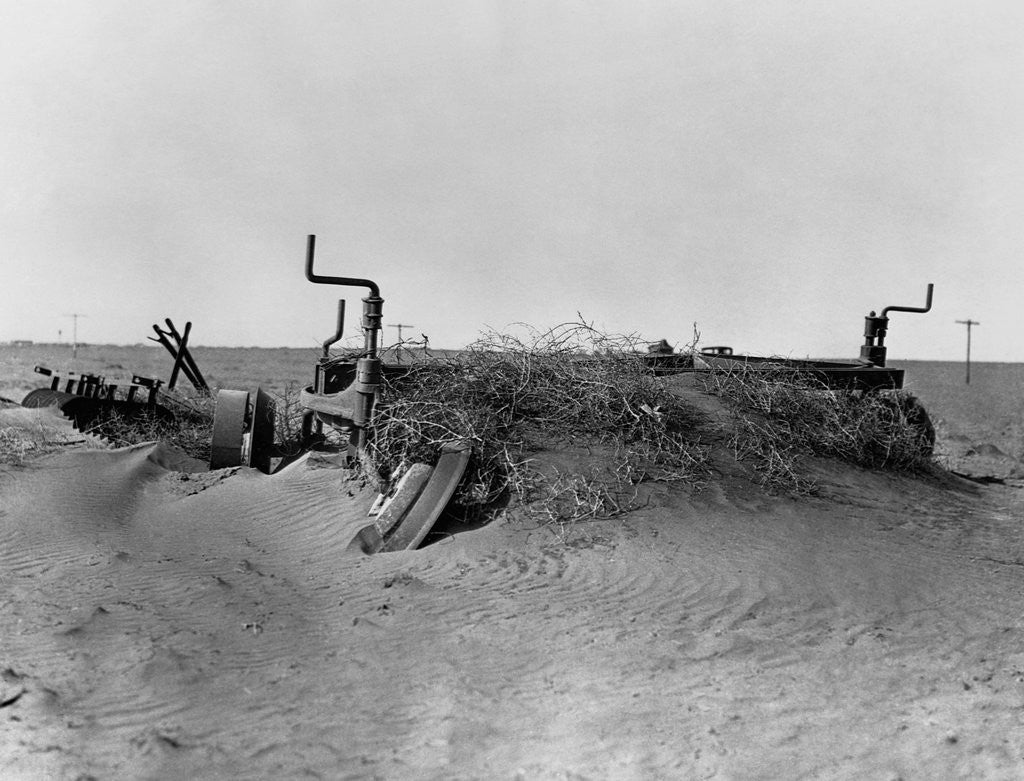 Detail of Farm Machinery Buried in Sand by Corbis