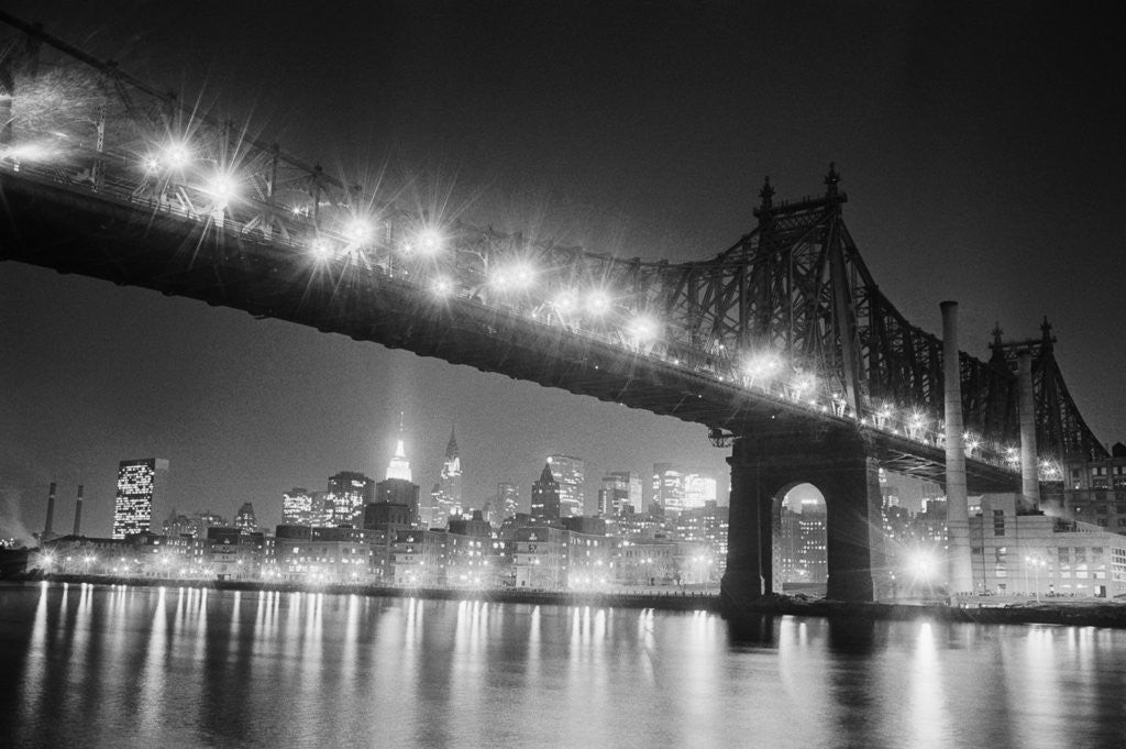 Detail of Queensboro Bridge and Manhattan at Night by Corbis