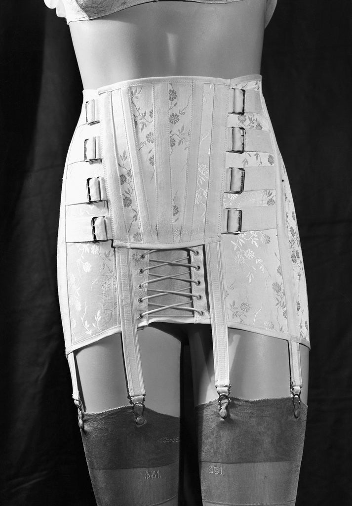 Detail of Girdle With Garters Displayed on Mannequin by Corbis