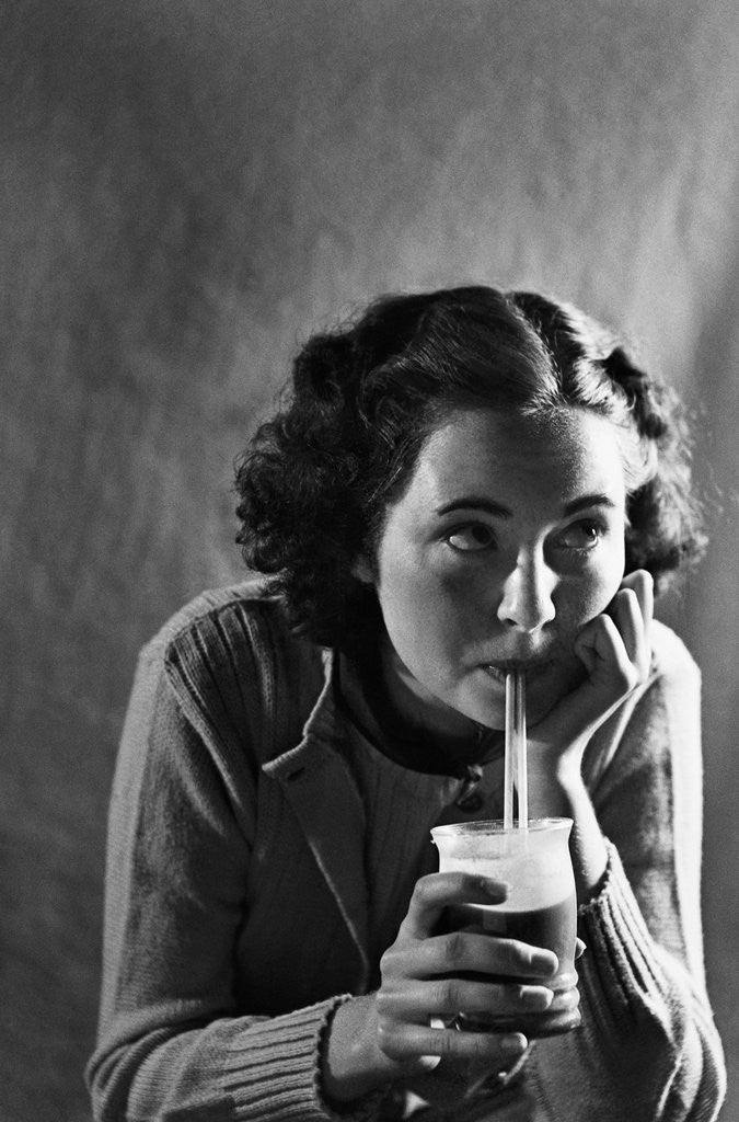 Detail of Girl Sipping a Soda by Corbis