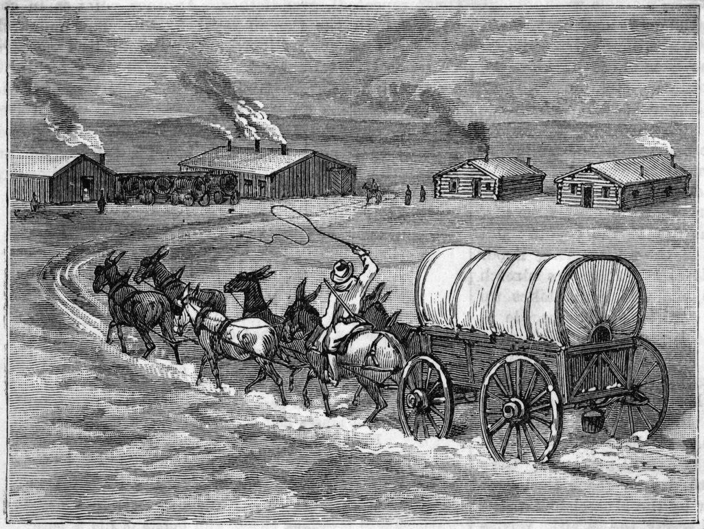Detail of Covered Wagon Approaching Log Cabins by Corbis