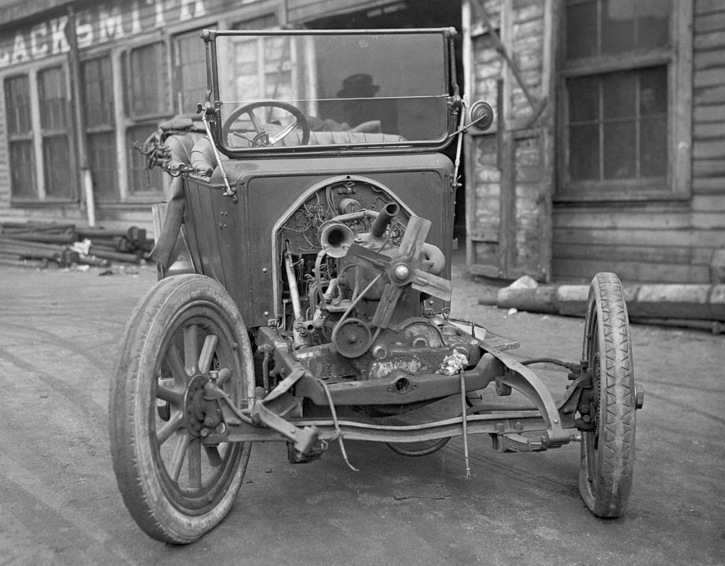 Detail of Exposed Engine of Early Automobile by Corbis