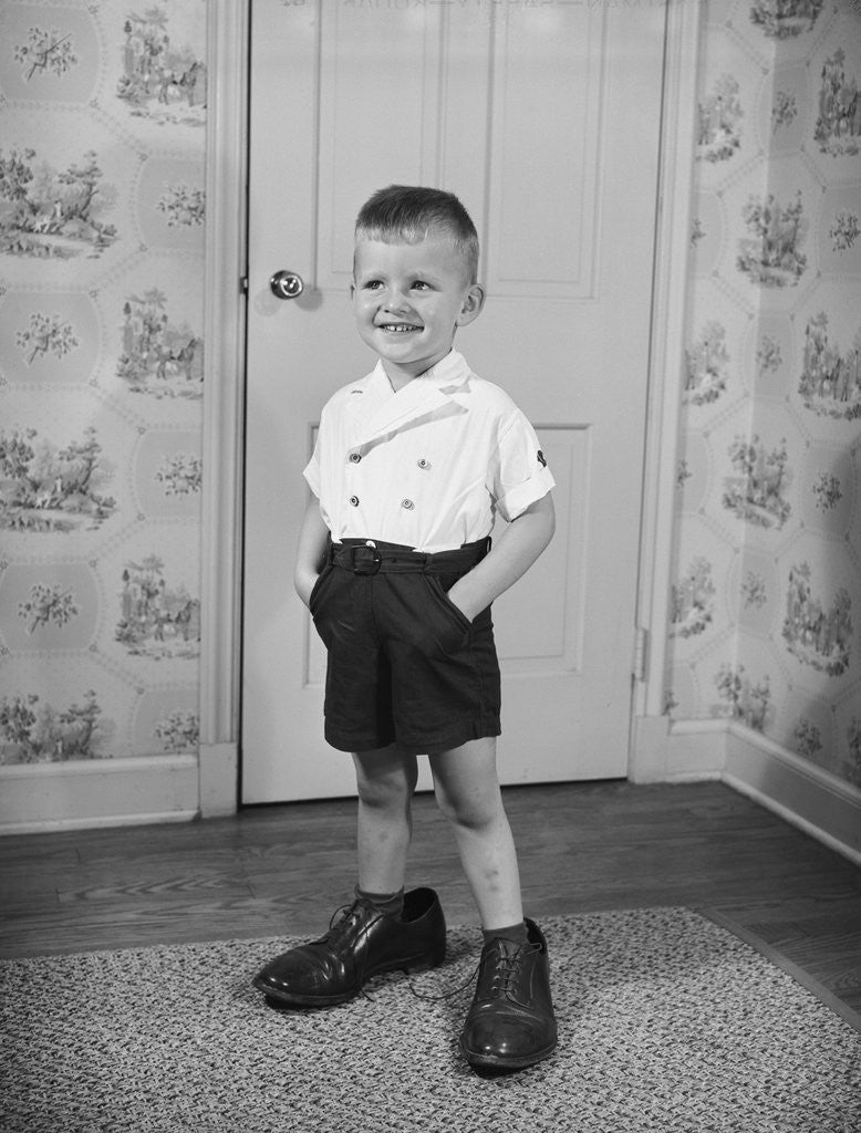 Detail of Boy Standing in Oversized Shoes by Corbis