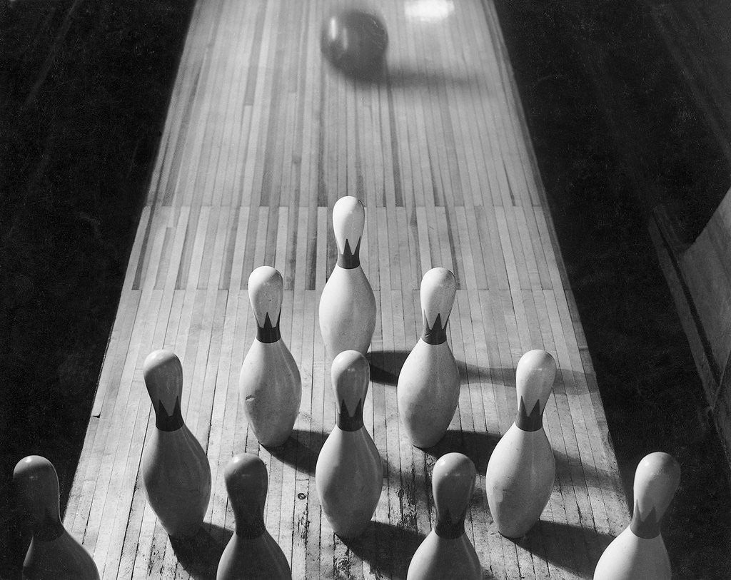 Detail of Bowling Ball Rolling Toward Pins by Corbis