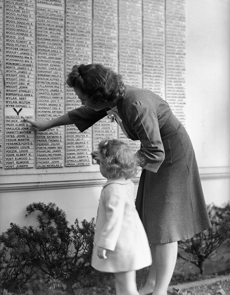 Detail of Woman And Daughter At Honor Roll Wall by Corbis