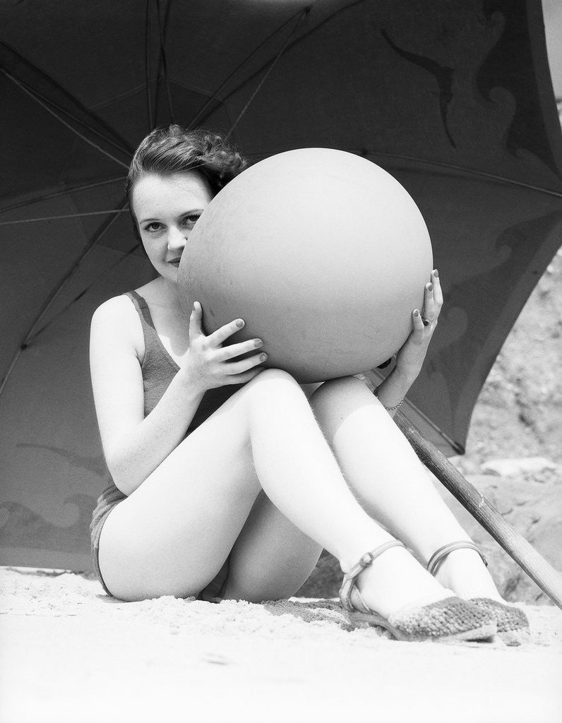 Detail of Woman in Bathing Suit Holding Beach Ball by Corbis