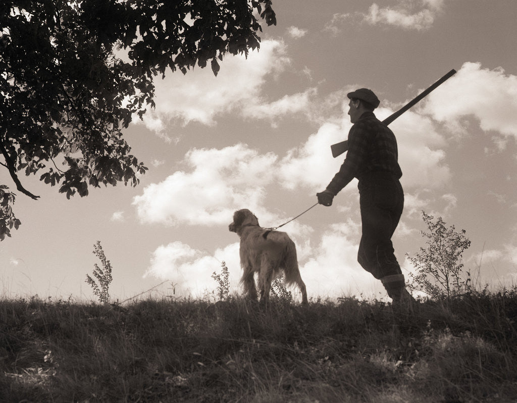 Detail of Hunter Walking with Bird Dog by Corbis