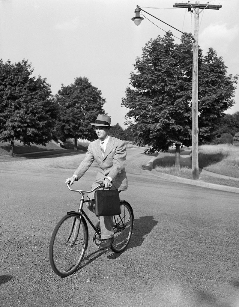 Detail of Business Man Riding Bicycle by Corbis