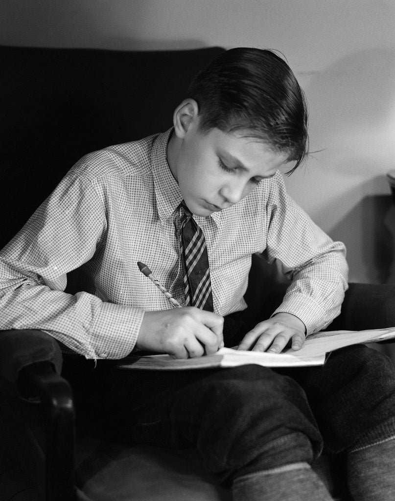 Detail of Seated Boy Doing Homework by Corbis