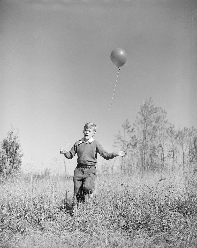 Detail of Boy Holding a Balloon by Corbis