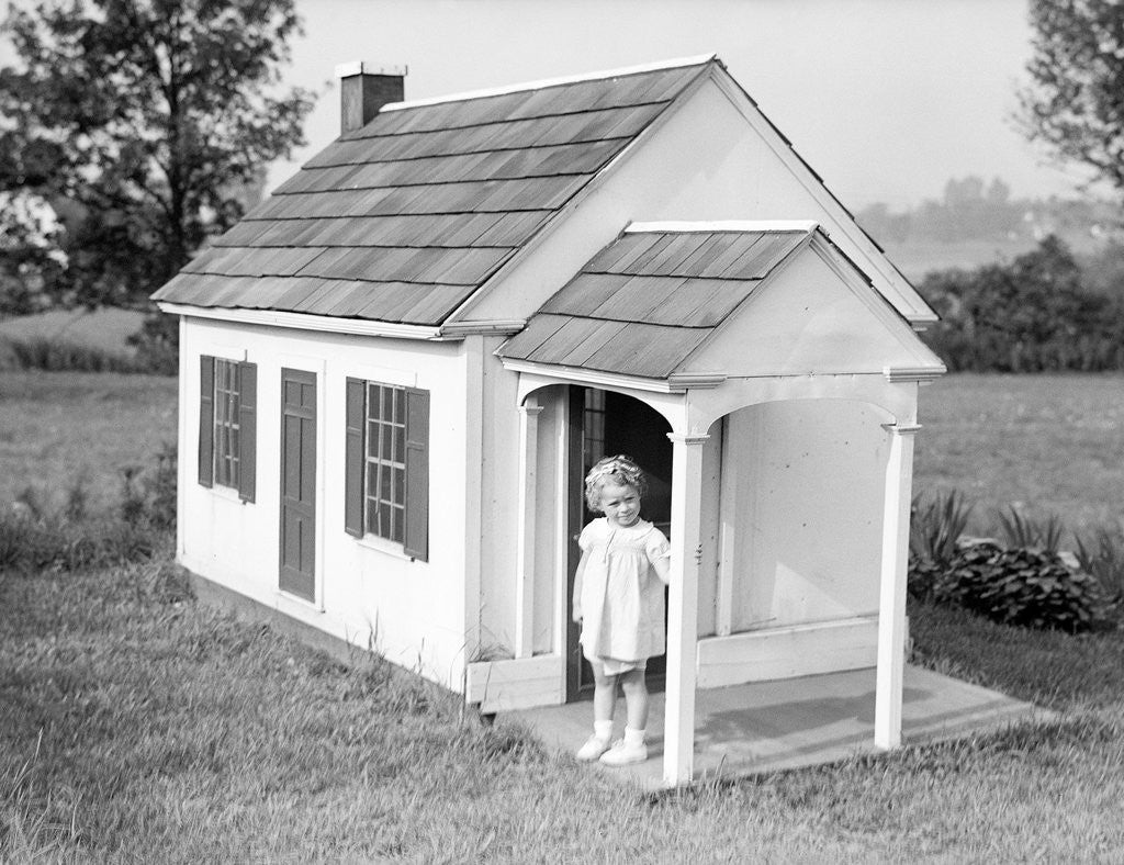 Detail of Girl Standing on Playhouse Porch in Massachusetts by Corbis