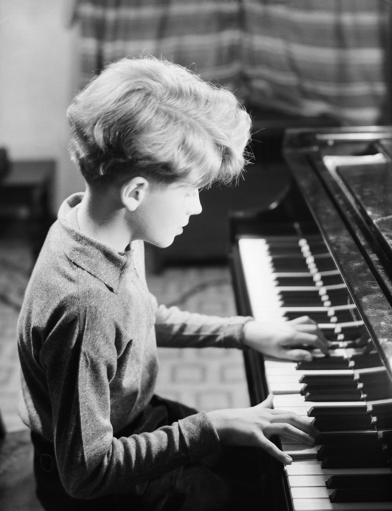 Detail of Boy Practicing Piano by Corbis