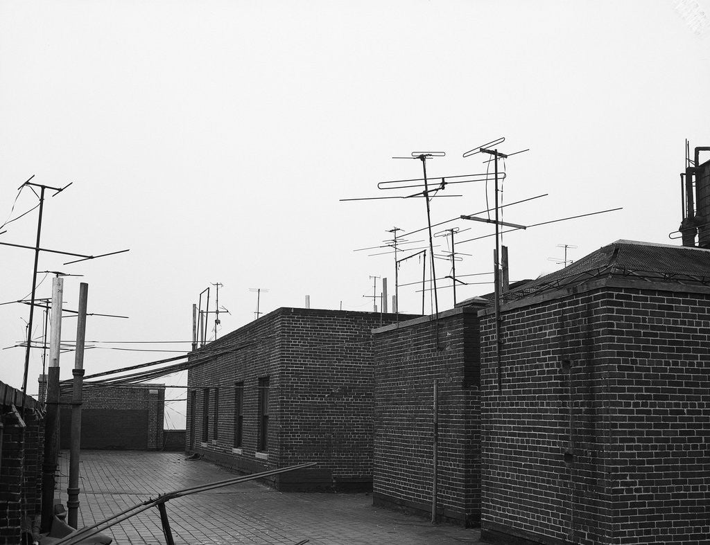 Detail of Antennas on Rooftop by Corbis