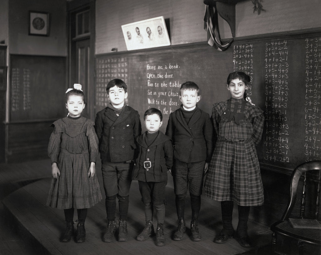 Detail of Children Posing in Classroom by Corbis