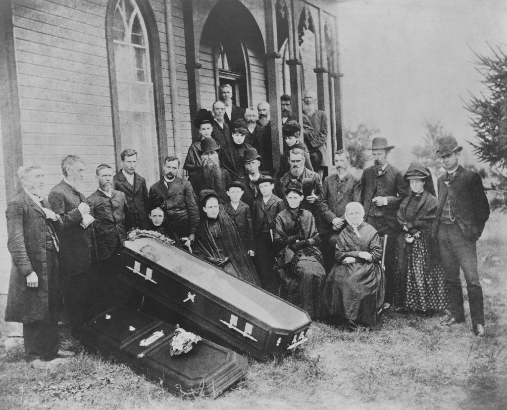 Detail of Family with Open Coffin by Corbis