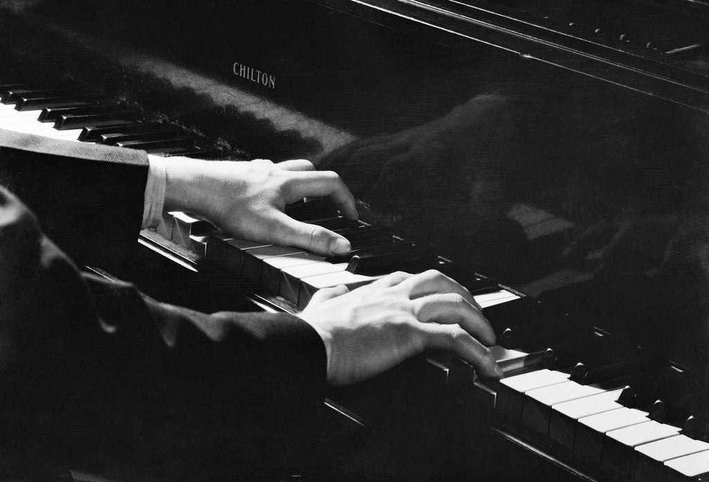 Detail of Hands Playing Keys of Chilton Piano by Corbis