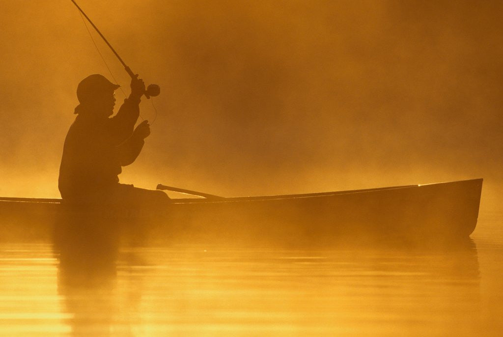 Detail of Fly Fishing from a Canoe by Corbis