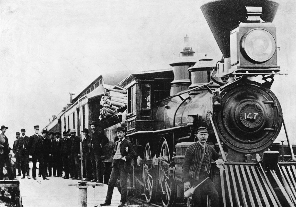 Detail of Men and Canadian Steam Locomotive by Corbis