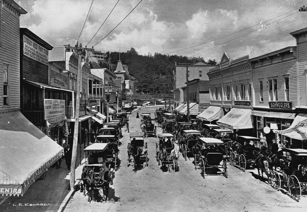 Detail of Horse-Drawn Carriages and Storefronts on Mackinac Island by Corbis