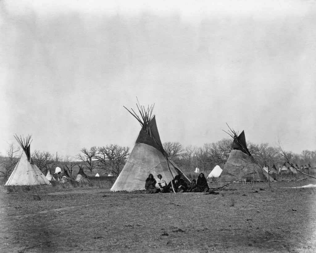 Detail of A Native American Family Sits Outside Their Teepee by Corbis