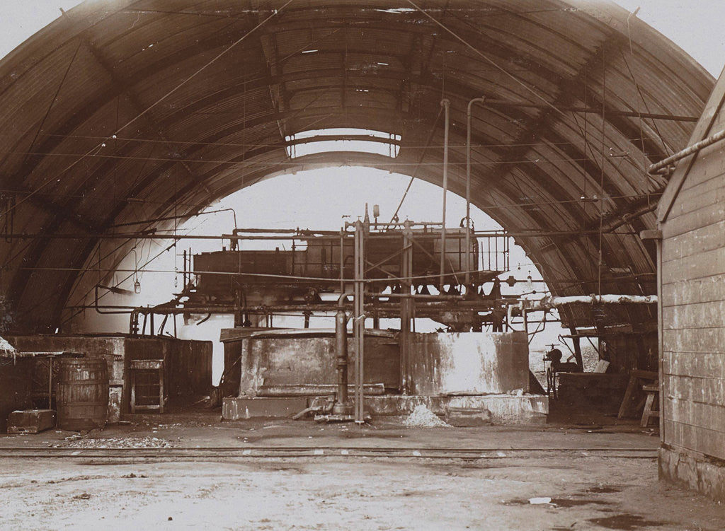 Detail of Interior of a half-round factory with a machine and pipe lines by Anonymous