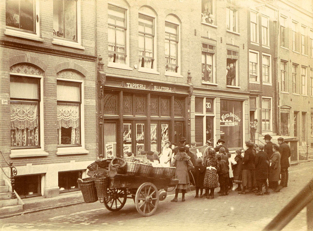 Detail of Children and adults watch the work for a liquor store and waffle bakery Jac. van der Zee by Anonymous