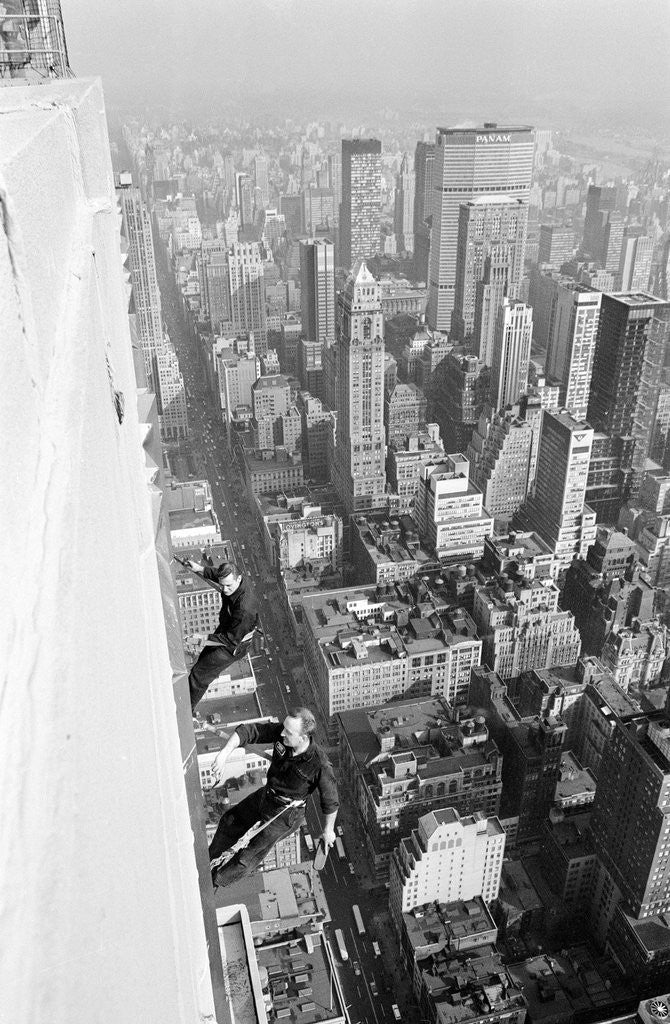 Detail of Workmen busy cleaning windows 1000 ft up the Empire State building by Daily Herald
