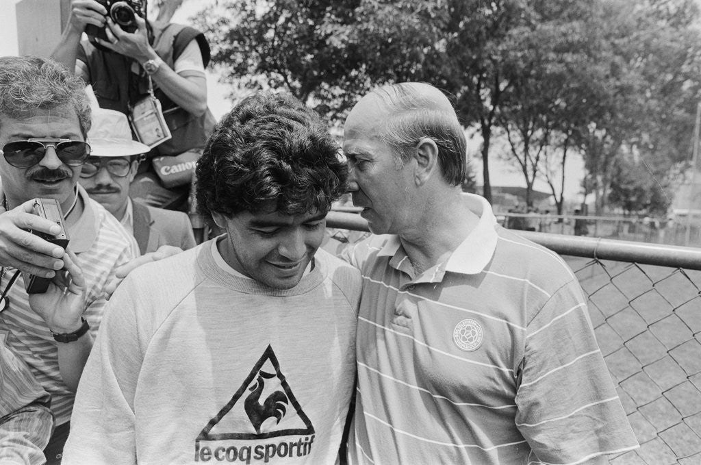 Detail of Argentina footballer Diego Maradona speaks to former England footballer Bobby Charlton, 1986 World Cup Finals in Mexico by Monte Fresco