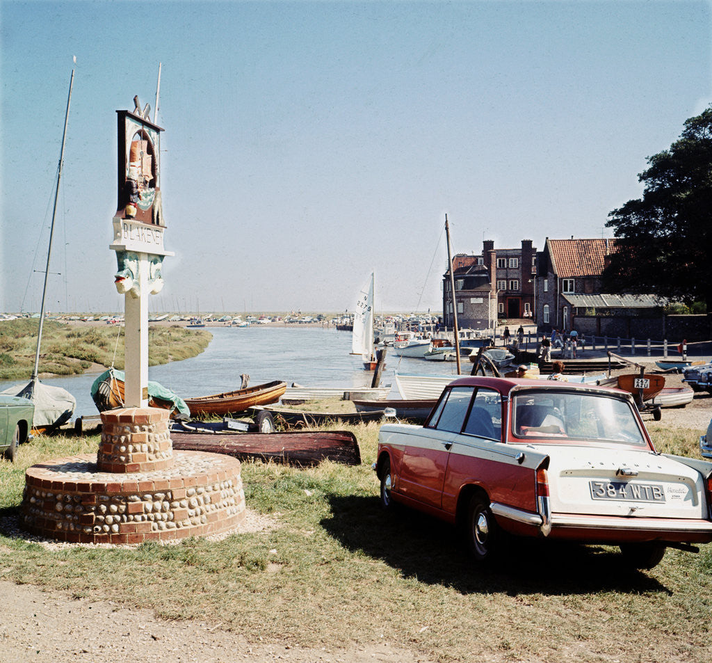 Detail of A Triumph hearld car parked next to a signpost at Blakeney by Anonymous