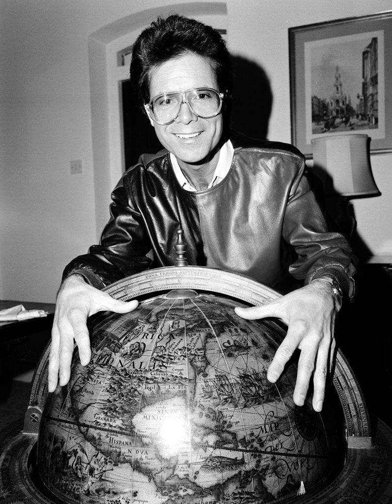 Detail of Cliff Richard with a globe by Anonymous