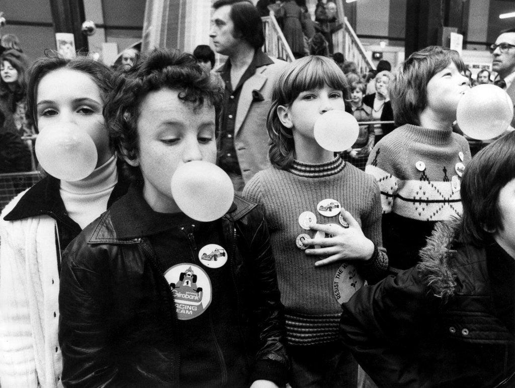 Detail of Children blowing bubble gum at Alexandra Palace by Charlie Ley