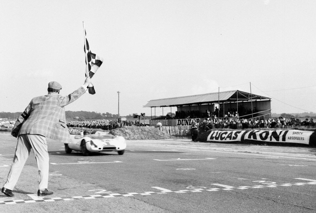 Detail of Jim Clark takes the checkered flag by Staff