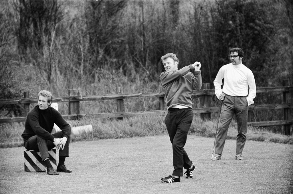 Detail of Billy Bremner tees off watched by Denis Law by Monte Fresco