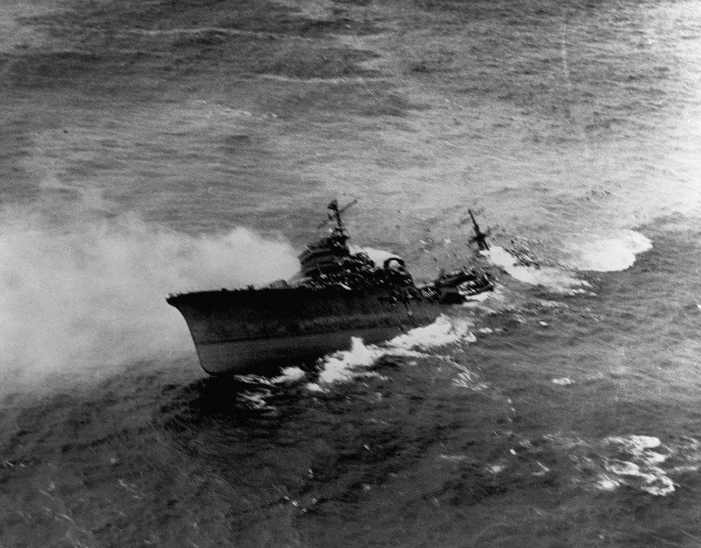 Detail of A Japanese cruiser (Katori Class) sinking off the coast of French Indo-China after attack by SB2c's from the USS Hancock. January 12, 1945 by Corbis