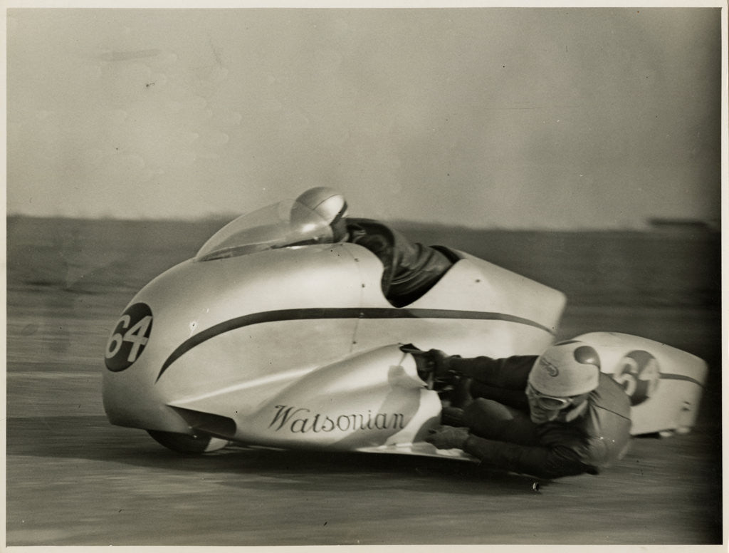 Detail of Eric Oliver, driving Watsonian sidecar outfit, Silverstone, 1954 by T.M. Badger