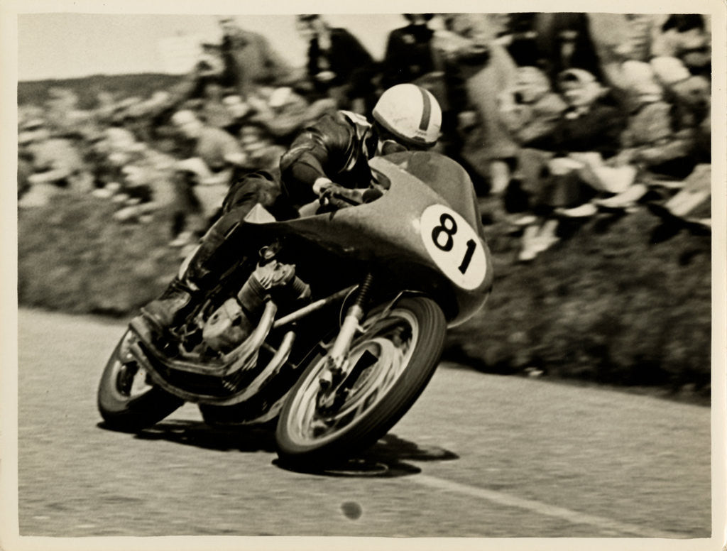 Detail of John Surtees riding as number 81 at Kate's Cottage, 1956 Senior TT (Tourist Trophy) by T.M. Badger