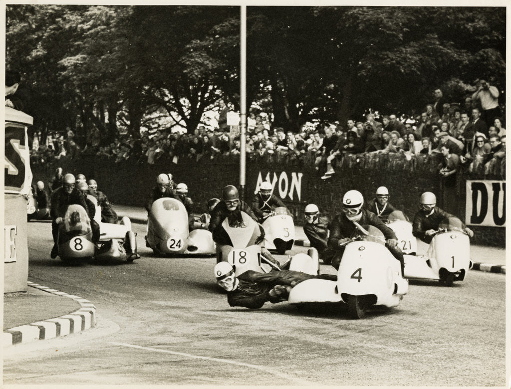 Detail of L. Neusser, driving a BMW sidecar outfit leads the field around Parkfield Corner, following the mass start of the1958 Sidecar TT by T.M. Badger