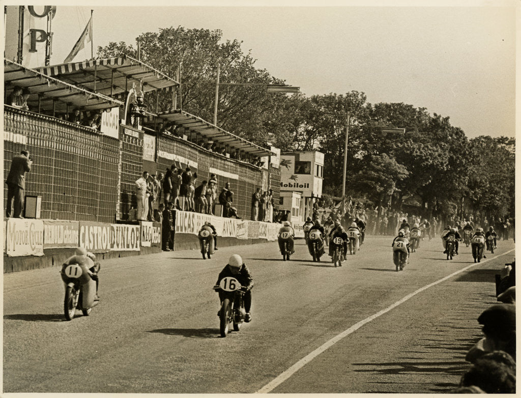 Detail of Competitors leaving the start line during the mass start of the 1958 250cc TT (Tourist Trophy) by T.M. Badger