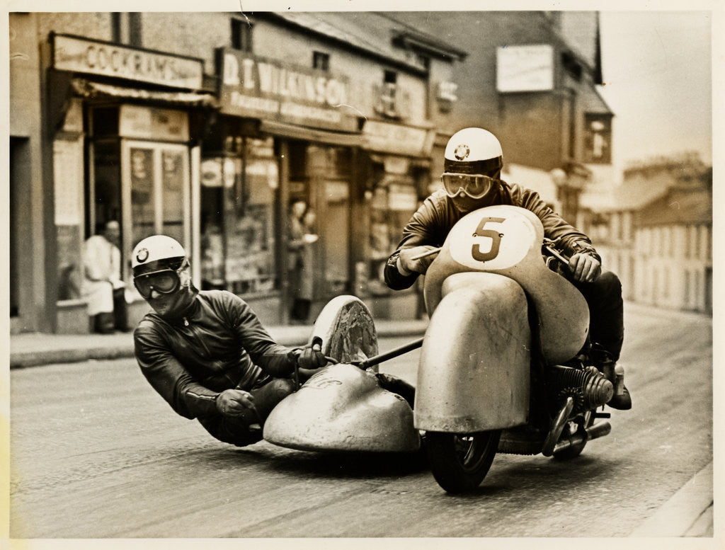 Detail of BMW sidecar outfit (number 5) passing through Onchan village by T.M. Badger
