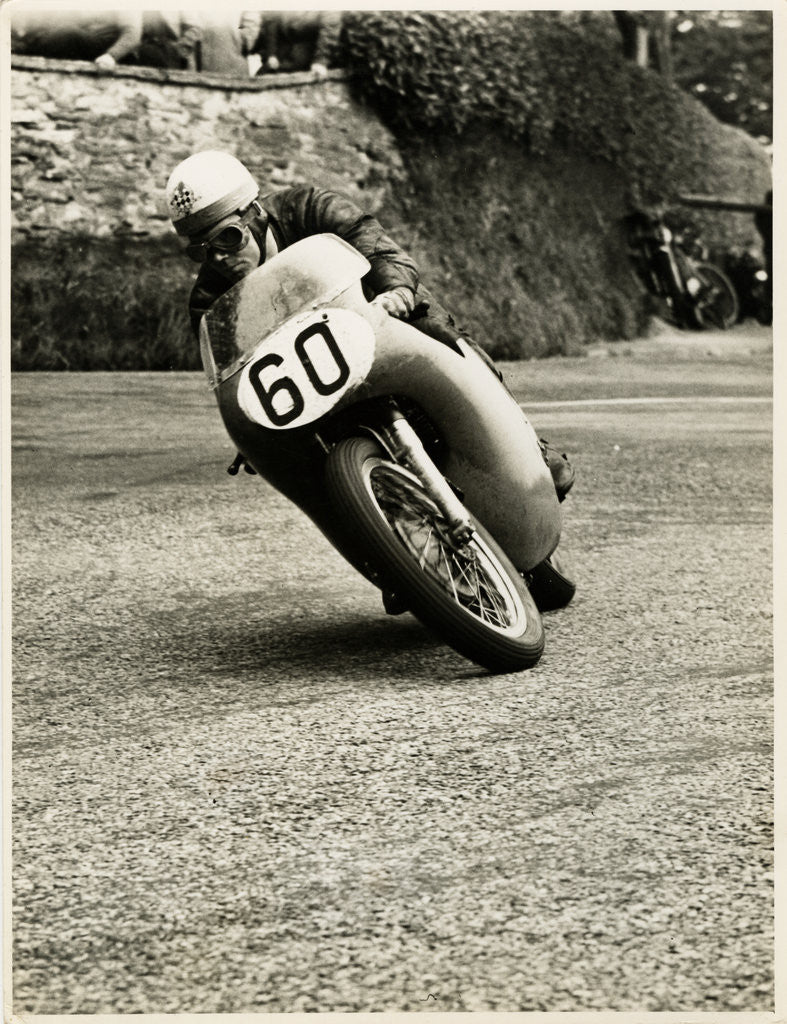 Detail of Eric Hinton, TT (Tourist Trophy) rider, riding 500cc Norton (number 60) by T.M. Badger