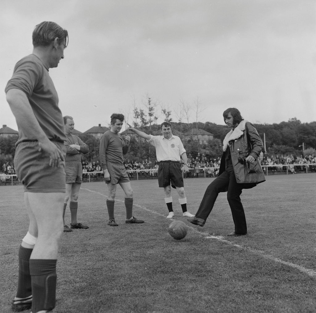 Detail of George Best kicking-off charity football match by Manx Press Pictures