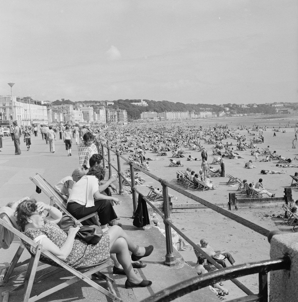 Detail of Holidaymakers on Douglas beach by Manx Press Pictures