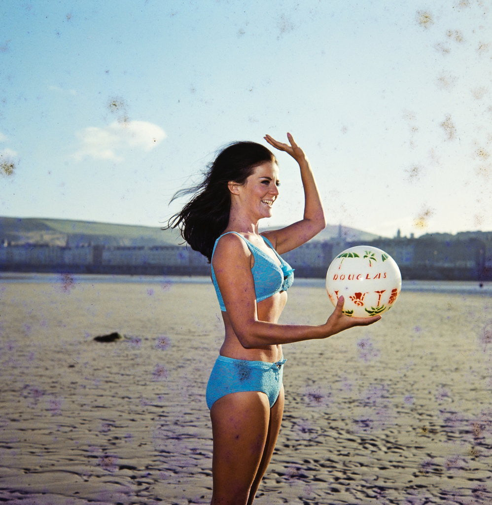 Detail of Glamour girl on Douglas beach with beachball by Manx Press Pictures