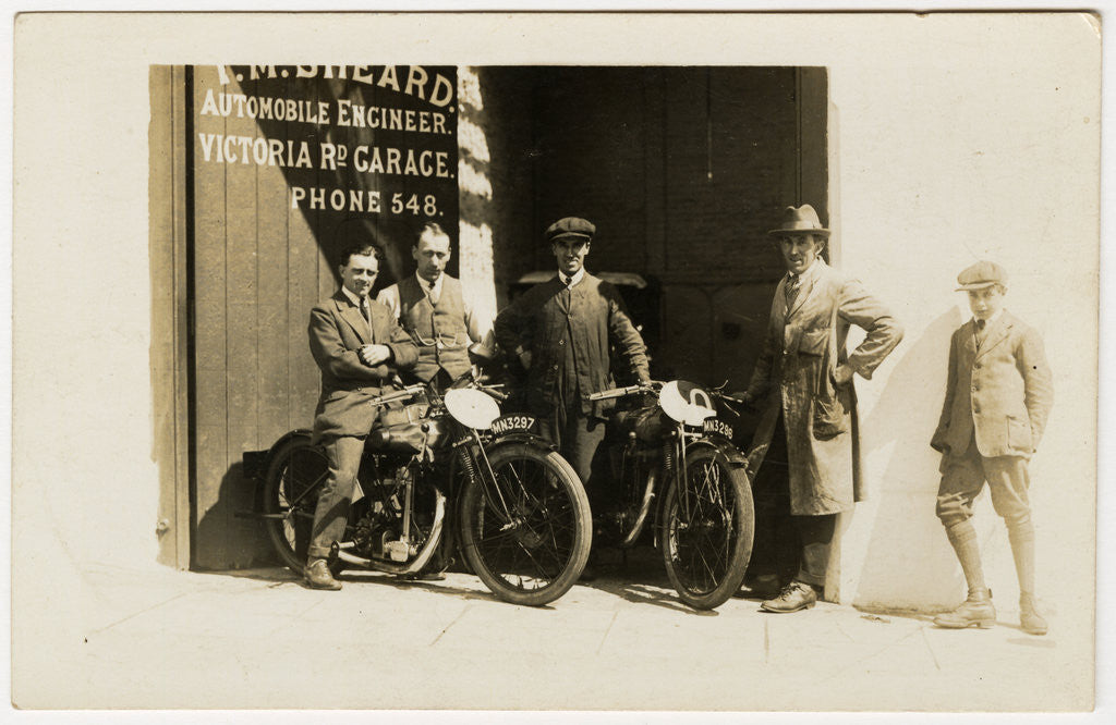 Detail of Group of riders and mechanics outside the garage of T.M.Sheard, TT (Tourist Trophy) rider, Automobile Engineer, Victoria Road Garage by Thomas Horsfell Midwood