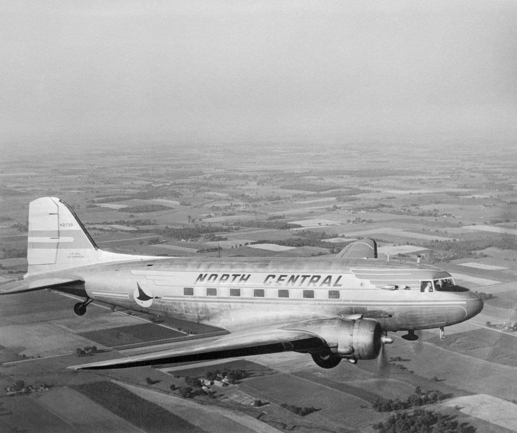 Detail of Douglas DC-3 Plane in Flight by Corbis